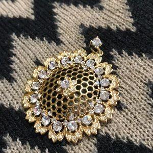 Nolan Miller honey comb gold plated pendant